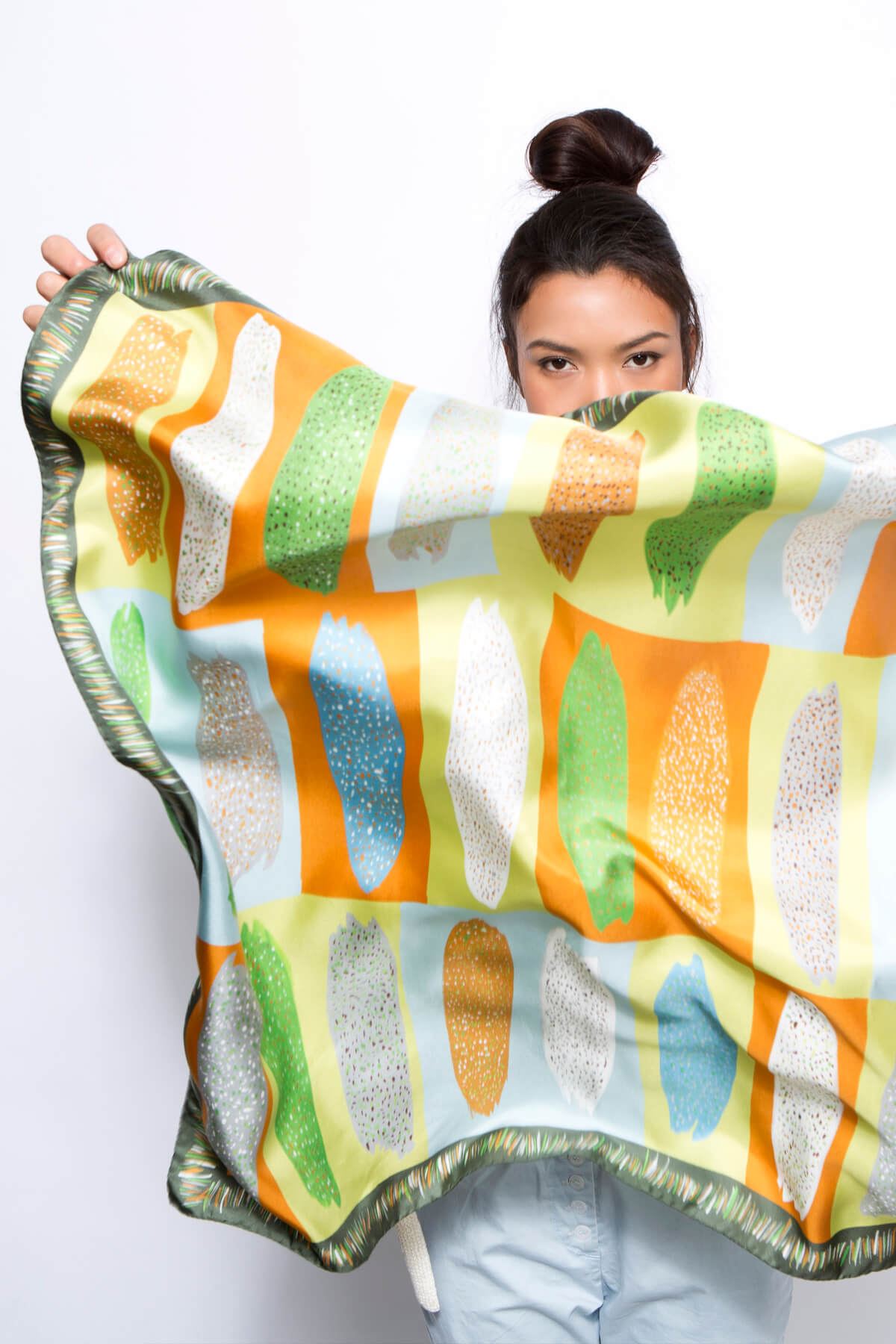 printed silk scarf, green, ochre, light blue, african pattern by dikla levsky, made in Italy