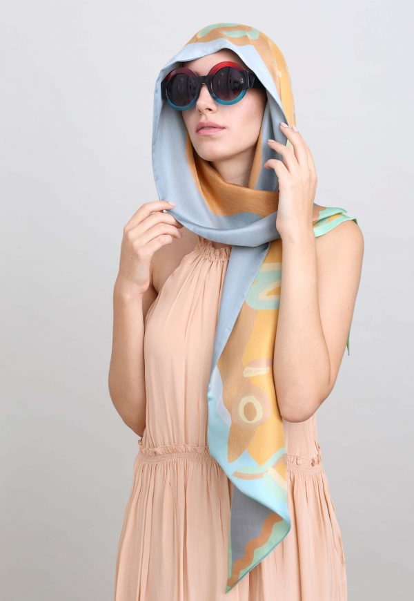 Printed reversible scarf in soft mint and sand colors